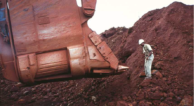 Large-scale mining equipment being directed